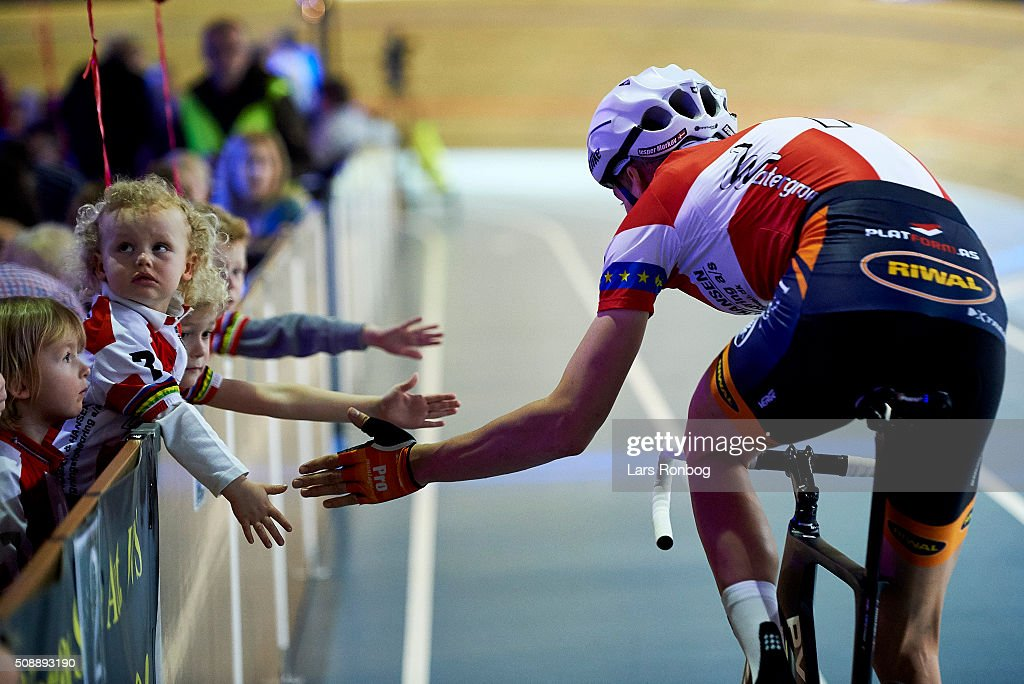 Jesper Morkov gives high five to young fans during day four at the Copenhagen Six Days Race Cycling at Ballerup Super Arena on February 7, 2016 in Ballerup, Denmark.