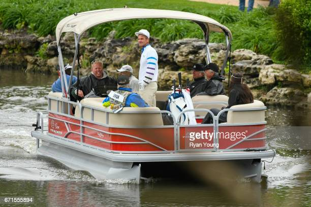 Jesper Parnevik and his playing partners ride the boat to the sixth green during the first round of the PGA TOUR Champions Bass Pro Shops Legends of...