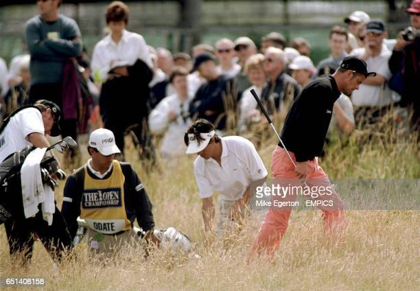 Jesper Parnevik hunts for his ball during the second round