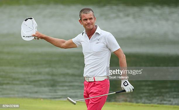 Jesper Parnevik of Sweden celebrates on the 18th green after his fourstroke victory at the Insperity Invitational at The Woodlands Country Club on...