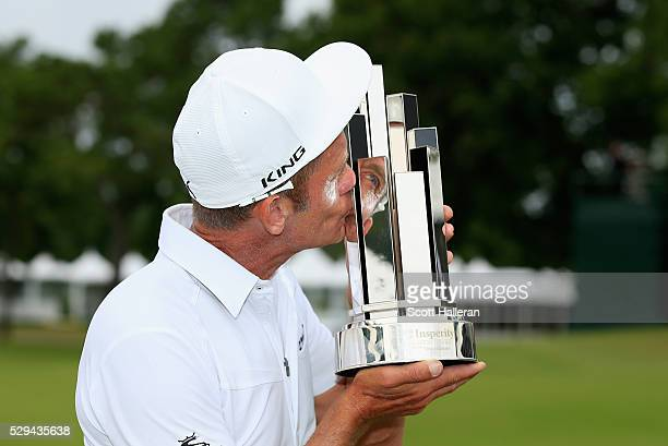 Jesper Parnevik of Sweden kisses the winner's trophy after his fourstroke victory at the Insperity Invitational at The Woodlands Country Club on May...