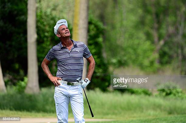 Jesper Parnevik of Sweden looks up after hitting from the 16th rough during the first round 2016 Senior PGA Championship presented by KitchenAid at...