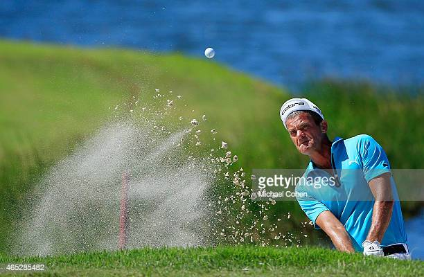 Jesper Parnevik of Sweden plays his shot from a bunker during round one of the Puerto Rico Open presented by Banco Popular at Trump International...