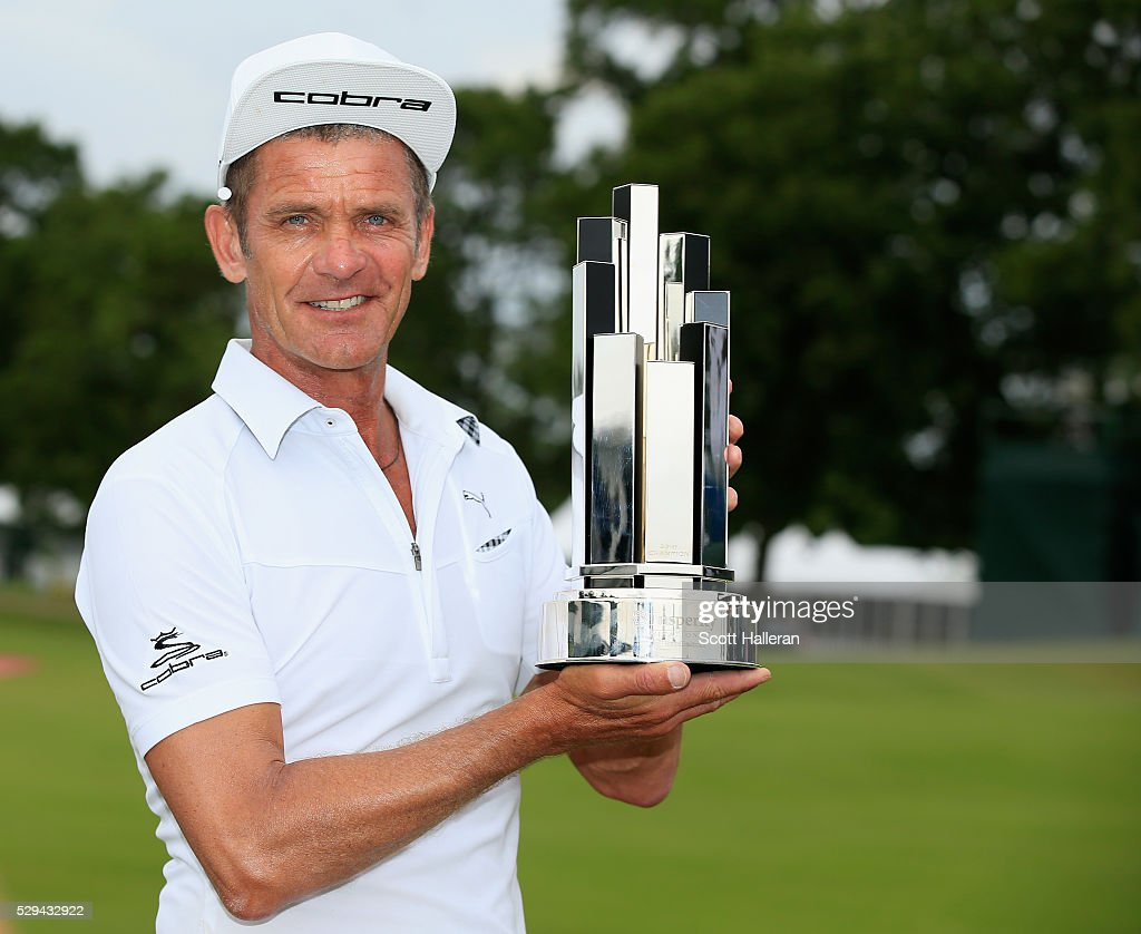 Jesper Parnevik of Sweden poses with the winner's trophy after his fourstroke victory at the Insperity Invitational at The Woodlands Country Club on...