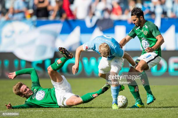 Jesper Svensson of Jonkopings Sodra and Anton Tinnerholm of Malmo FF and Andre Calisir of Jonkopings Sodra during the Allsvenskan match between Malmo...