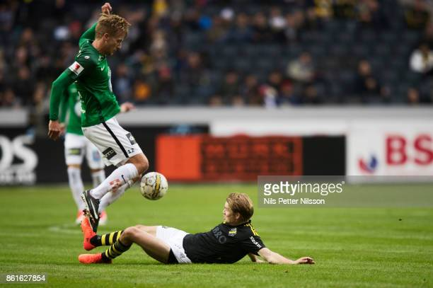 Jesper Svensson of Jonkopings Sodra and Johan Blomberg of AIK during the Allsvenskan match between AIK and Jonkopings Sodra IF at Friends Arena on...