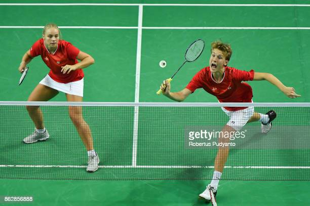 Jesper Toft and Alexandra Boje of Denmark compete against Chan Wang and Min Ji Kim of Korea during Mixed Doubles Round 32 match of the BWF World...
