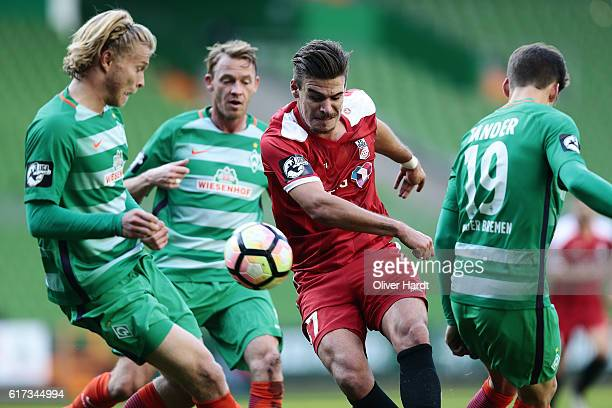 Jesper Verlaat of Bremen and Christopher Bieber of Erfurt compete for the ball during the 3 liga match between Werder Bremen II and RW Erfurt at...