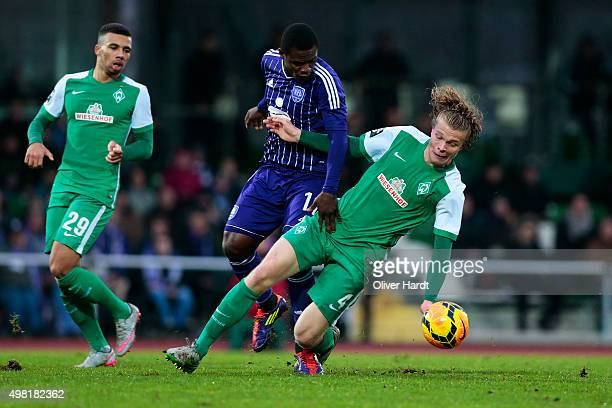 Jesper Verlaat of Bremen and Francky Sembolo of Osnabrueck compete for the ball during the 3Liga match between Werder Bremen II and VfL Osnabrueck on...
