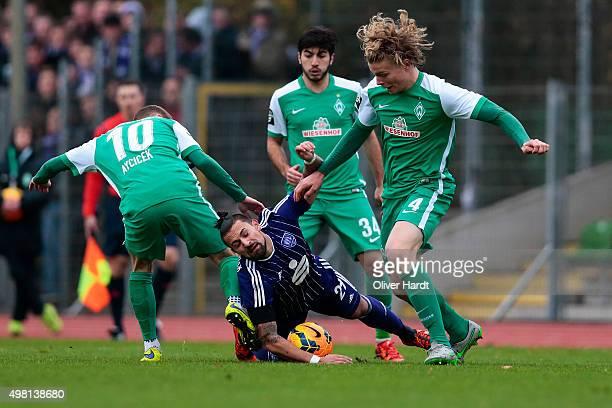 Jesper Verlaat of Bremen and Marcos Alvarez of Osnabrueck compete for the ball during the 3Liga match between Werder Bremen II and VfL Osnabrueck on...