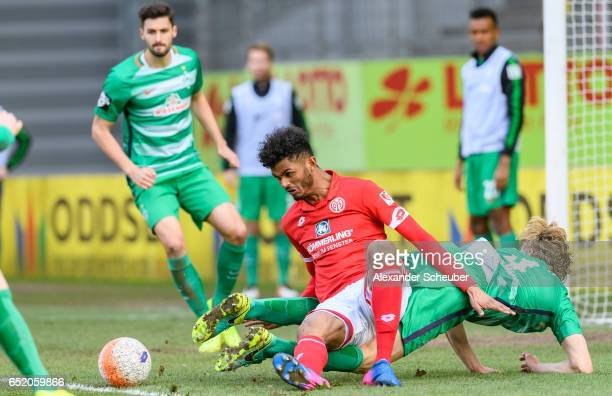 Jesper Verlaat of Bremen challenges Aaron Seydel of Mainz during the Third League match between Mainz 05 II and SV Werder Bremen II at Bruchweg...
