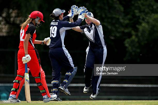 Jess Cameron of the Spirit celebrates with teammate Emma Inglis after she dismissed Alex Price of the Scorpions during the WNCL match between the...