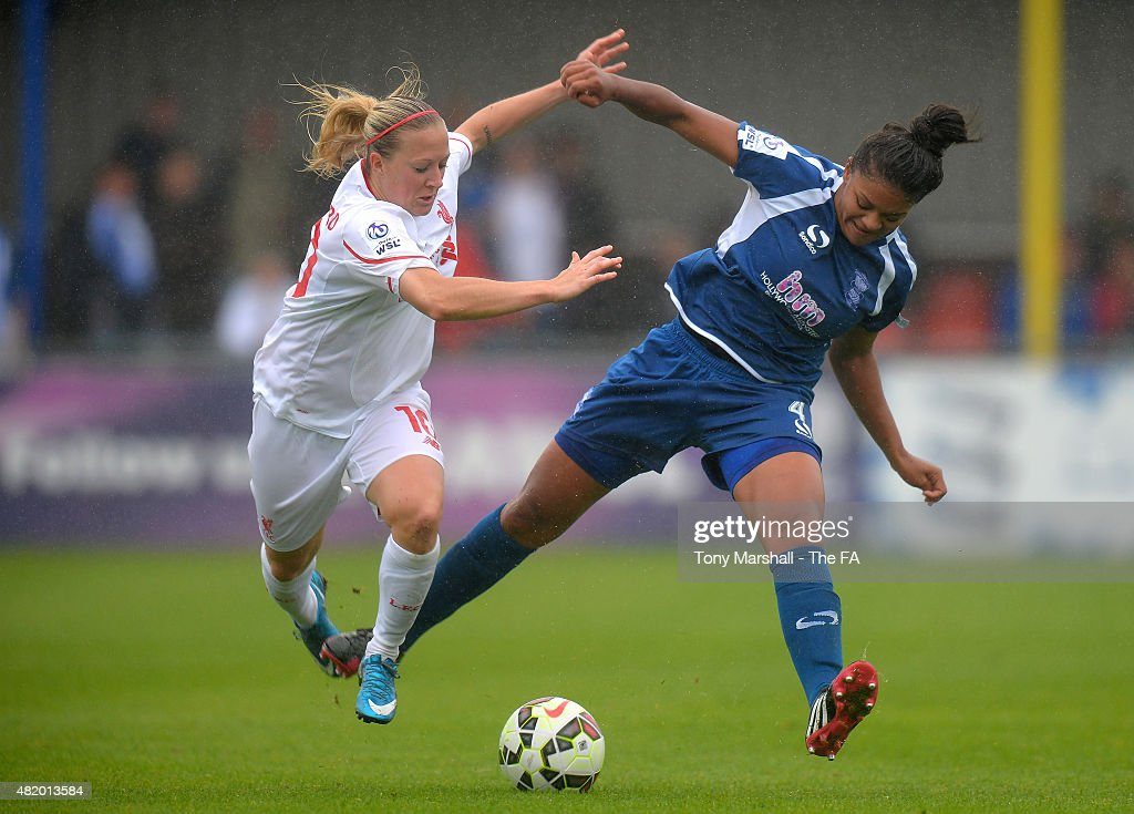 Jess Carter of Birmingham City Ladies is tackled by Line Smorsgard of Liverpool Ladies during the Women's Super League match between Birmingham City...