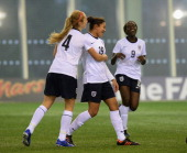 Jess Carter of England celebrates scoring their first goal during the England v Norway Under 19 Women's International match at St Georges Park on...