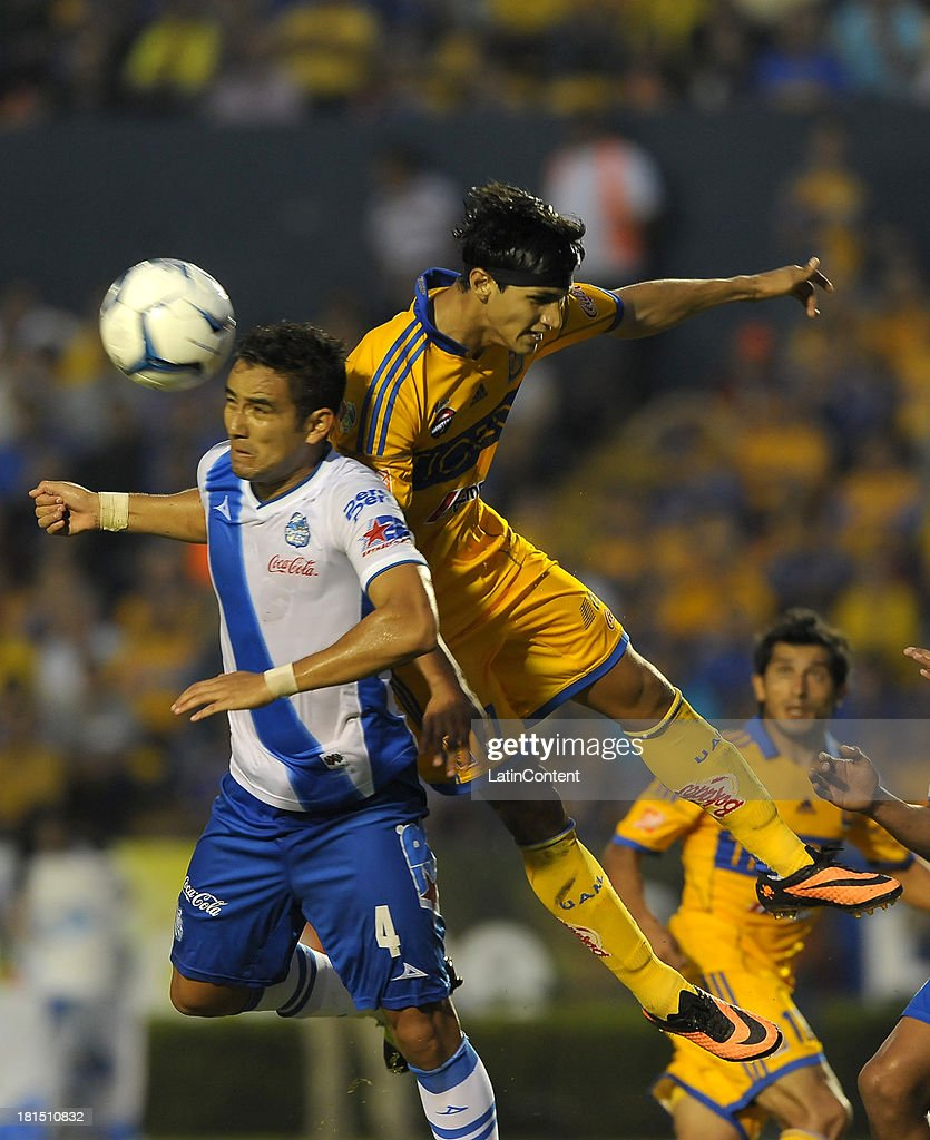 Jesús Chávez of Puebla jumps for the ball during a match between Tigres UANL and Puebla FC as part of the Liga MX at Universitario stadium on September 21, 2013 in Monterrey, Mexico.