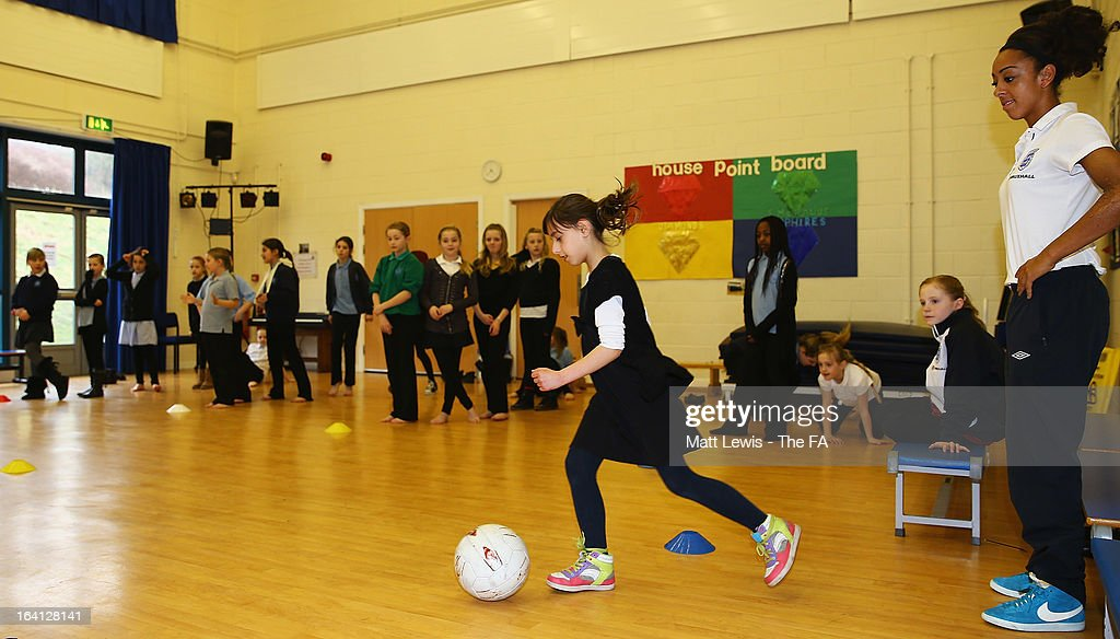 Jess Clarke of England and Lincoln Ladies promotes the Womens football match between England and Canada during a School visit to Meadow View Primary School on March 20, 2013 in Rotherham, England.