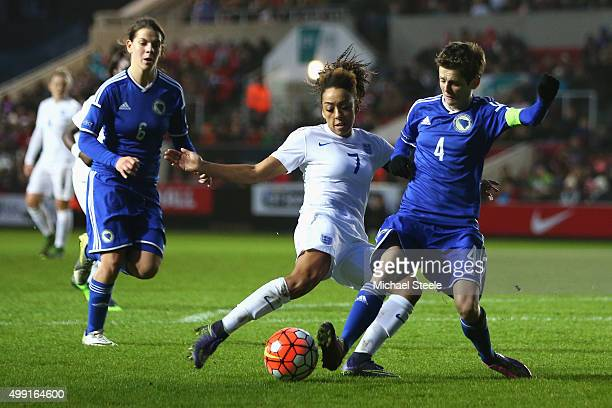 Jess Clarke of England has a shot blocked by Amira Spahic of Bosnia and Herzegovina during the UEFA Women's Euro 2017 Qualifier match between England...