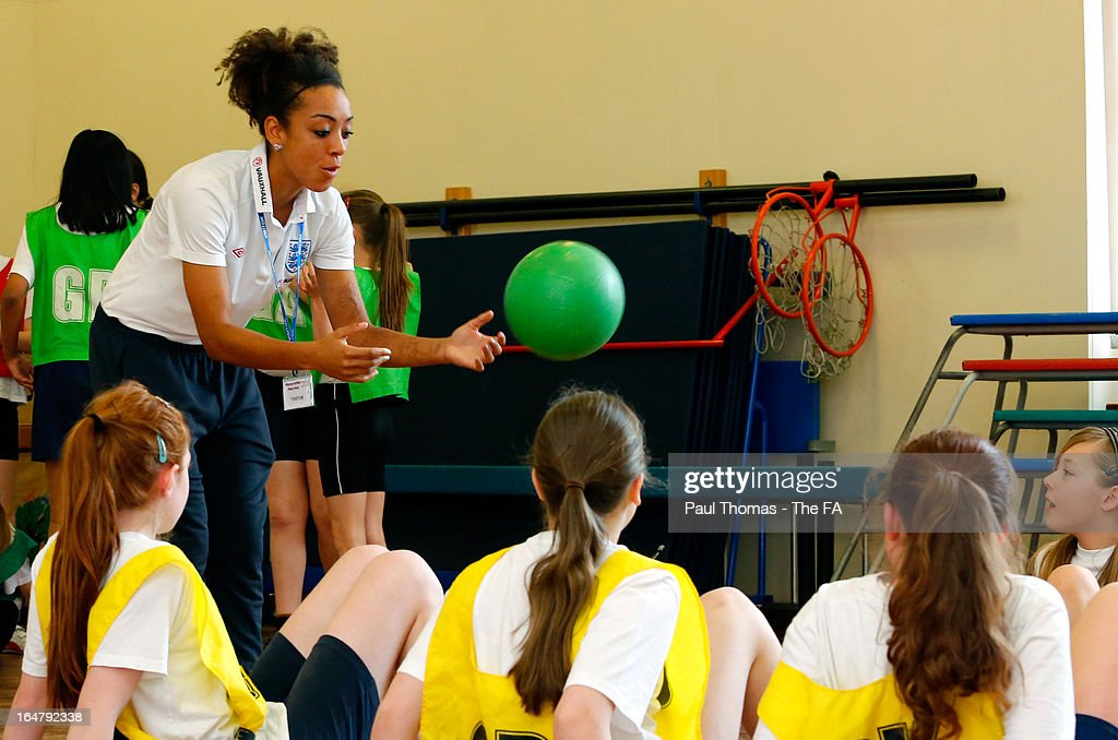 Jess Clarke of England participates during a sports lesson to promote the women's football match between England and Canada during a school visit to Wickersley Northfield School on March 28, 2013 in Rotherham, England.