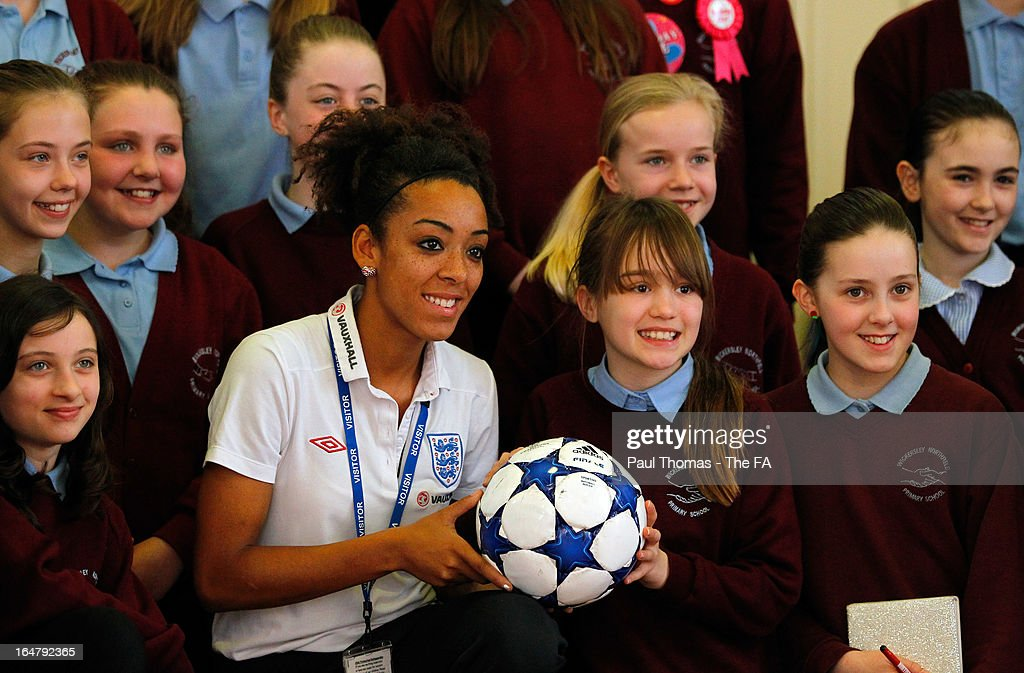 Jess Clarke of England poses for a photograph to promote the women's football match between England and Canada during a school visit to Wickersley Northfield School on March 28, 2013 in Rotherham, England.