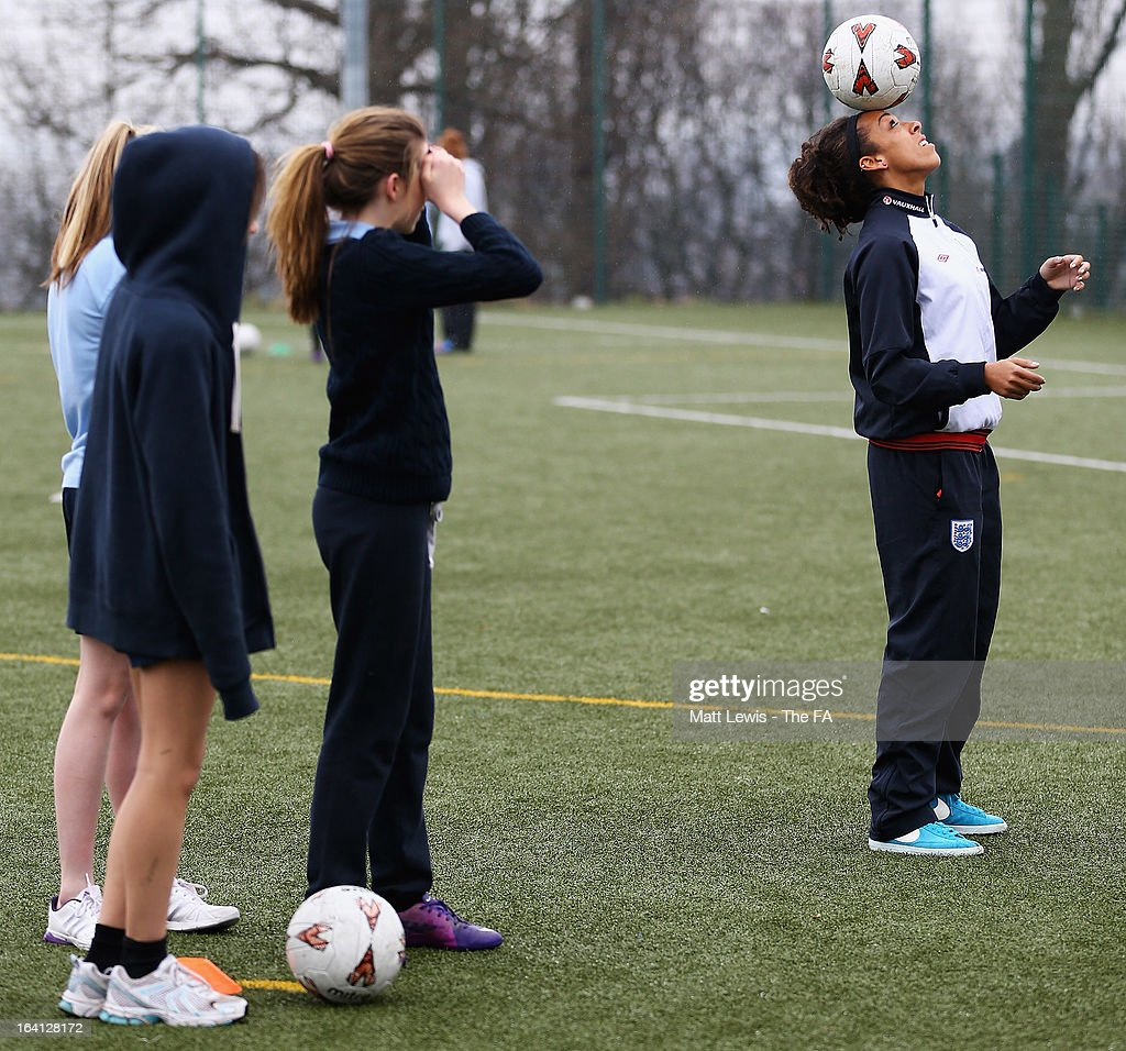 Jess Clarke of England promotes the Womens football match between England and Canada during a School visit to Wath Secondary School on March 20, 2013 in Rotherham, England.