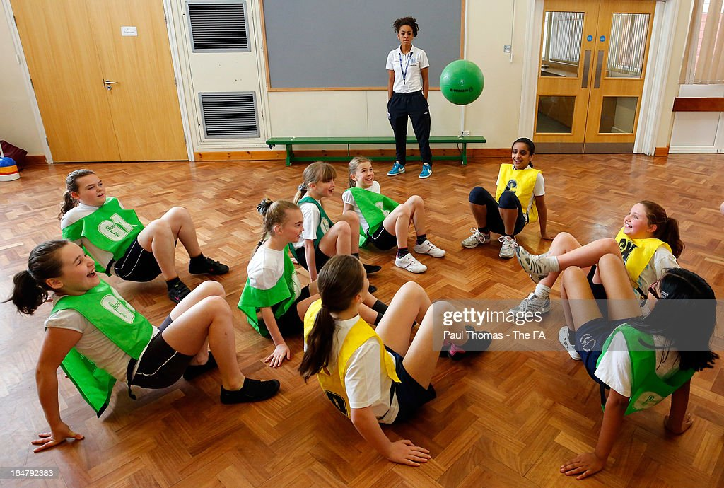 Jess Clarke of England referees during a sports lesson to promote the women's football match between England and Canada during a school visit to Wickersley Northfield School on March 28, 2013 in Rotherham, England.