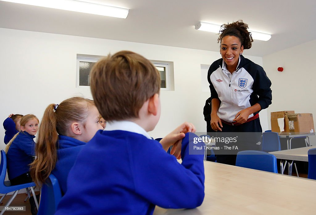 Jess Clarke of England speaks to a classroom to promote the women's football match between England and Canada during a school visit to Flanderwell Primary School on March 28, 2013 in Rotherham, England.