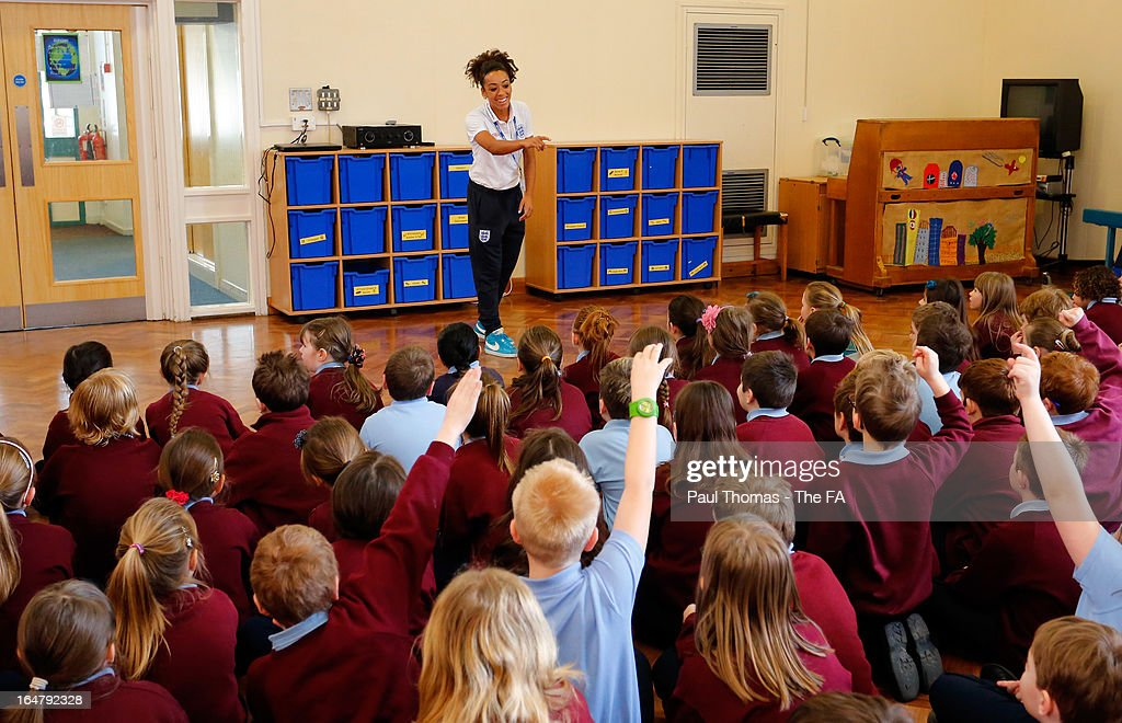 Jess Clarke of England speaks to an assembly to promote the women's football match between England and Canada during a school visit to Wickersley Northfield School on March 28, 2013 in Rotherham, England.
