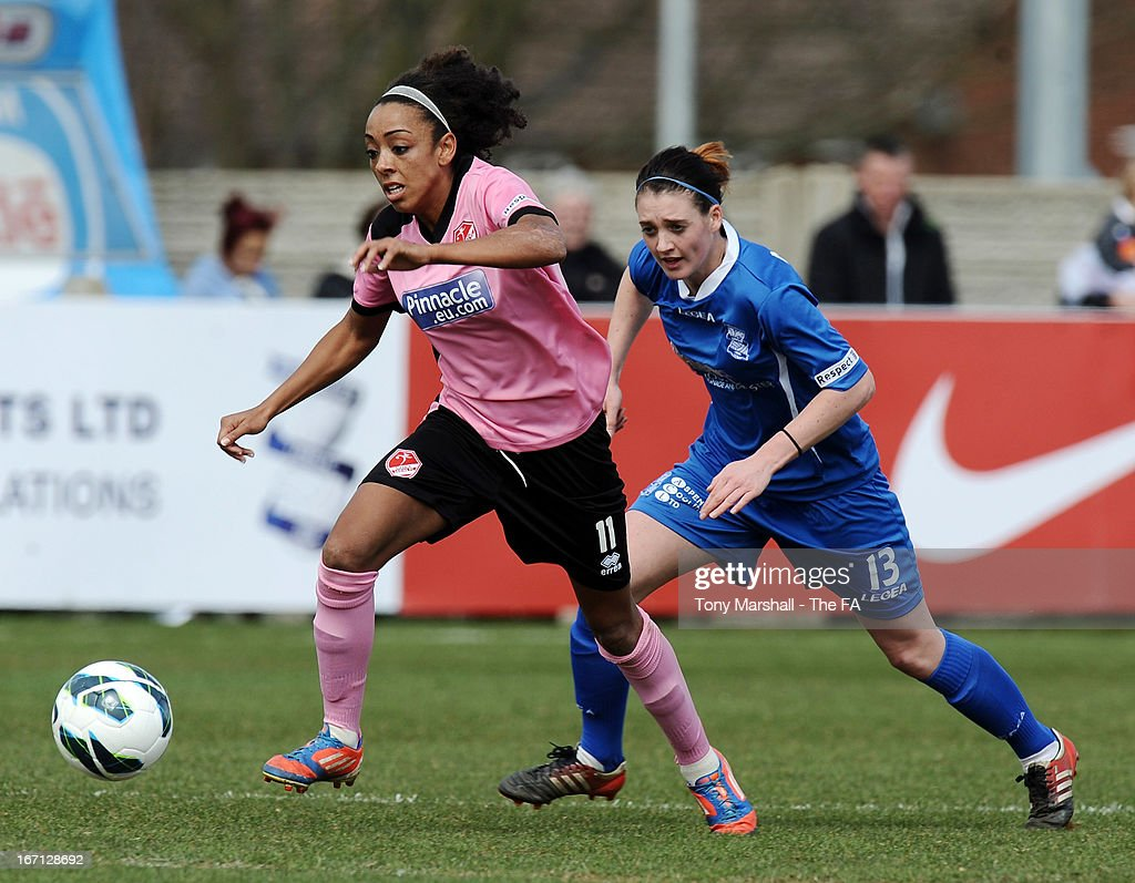 Jess Clarke of Lincoln Ladies (L) and Jade Moore of Birmingham City in action during the FA Women's Super League match between Birmingham City Ladies FC and Lincoln Ladies FC at DCS Stadium, Stratford Town FC on April 21, 2013 in Stratford, England.