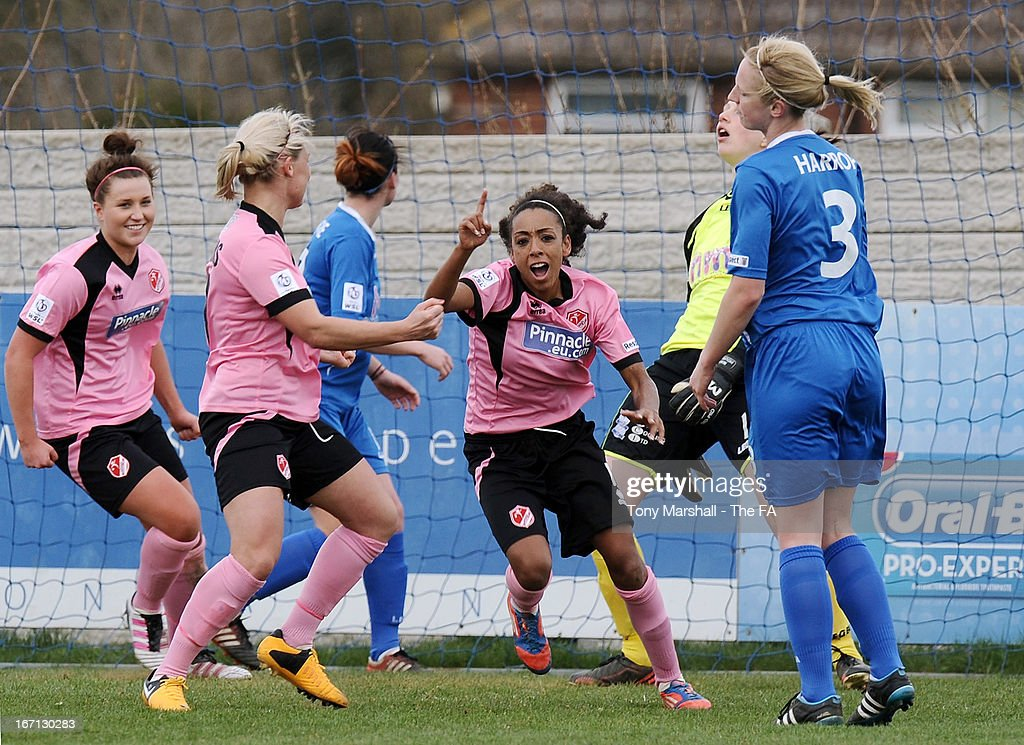 Jess Clarke of Lincoln Ladies (3rd R) celebrates after scoring her team's first goal during the FA Women's Super League match between Birmingham City Ladies FC and Lincoln Ladies FC at DCS Stadium, Stratford Town FC on April 21, 2013 in Stratford, England.