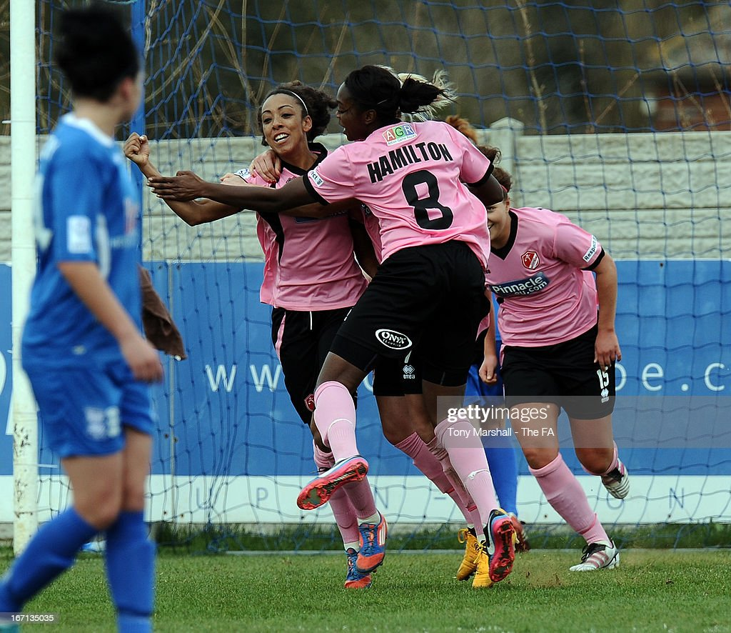 Jess Clarke of Lincoln Ladies celebrates with team-mates after scoring theirteam's first goal during the FA Women's Super League match between Birmingham City Ladies FC and Lincoln Ladies FC at DCS Stadium, Stratford Town FC on April 21, 2013 in Stratford, England.