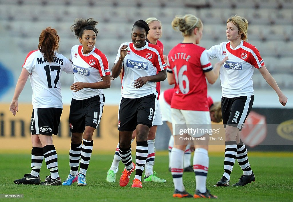 Jess Clarke of Lincoln Ladies is congratulated by her team-mates after scoring the opening goal during the The FA WSL Continental Cup match between Lincoln Ladies and Arsenal Ladies at Sincil Bank Stadium on May 2, 2013 in Lincoln, England.