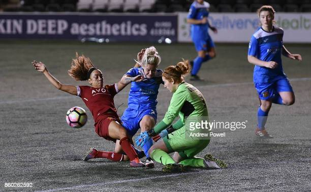 Jess Clarke of Liverpool Ladies competes with Ellie Gilliatt and Danielle Gibbons of Sheffield FC Ladies during the Women's Super League match...
