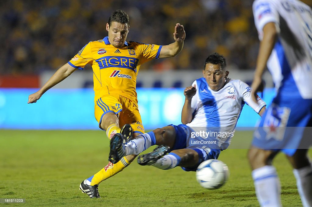 Jesús Dueñas Manzo of Tigres hits the ball during a match between Tigres UANL and Puebla FC as part of the Liga MX at Universitario stadium on September 21, 2013 in Monterrey, Mexico.
