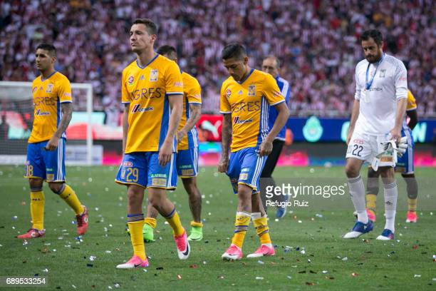 Jesús Dueñas Victor Sosa and Enrique Palos goalkeeper of Tigres look dejected after losing the Final second leg match between Chivas and Tigres UANL...