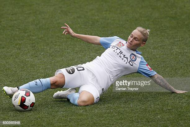 Jess Fishlock of Melbourne City slides for a ball during the round eight WLeague match between Melbourne City and Perth at AAMI Park on December 27...
