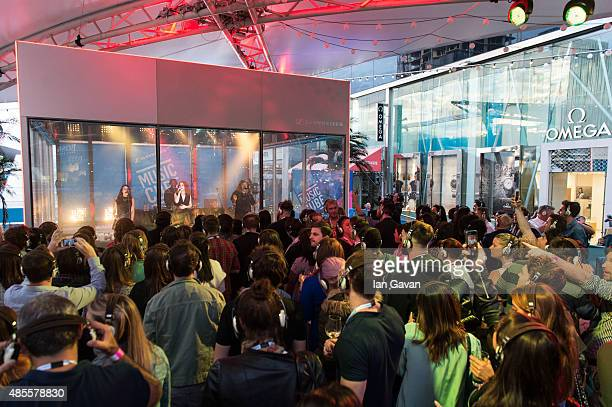 Jess Glynne performs on stage during a launch for MUSIC CUBE at Westfield Stratford City on August 28 2015 in London England