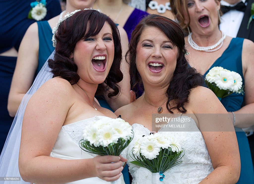 Jess Ives (R) and Rachel Briscoe (L) from the Bay of Islands celebrate being married during the first same sex marriage at the Rotorua Museum in Rotorua on Monday, August 19, 2013. More than 30 same-sex couples will say 'I do' on Monday when New Zealand becomes the first Asia-Pacific country and only the 14th in the world to legalise gay marriage. The move has sparked a raft of competitions to set wedding firsts, but unease amongst the religious community.