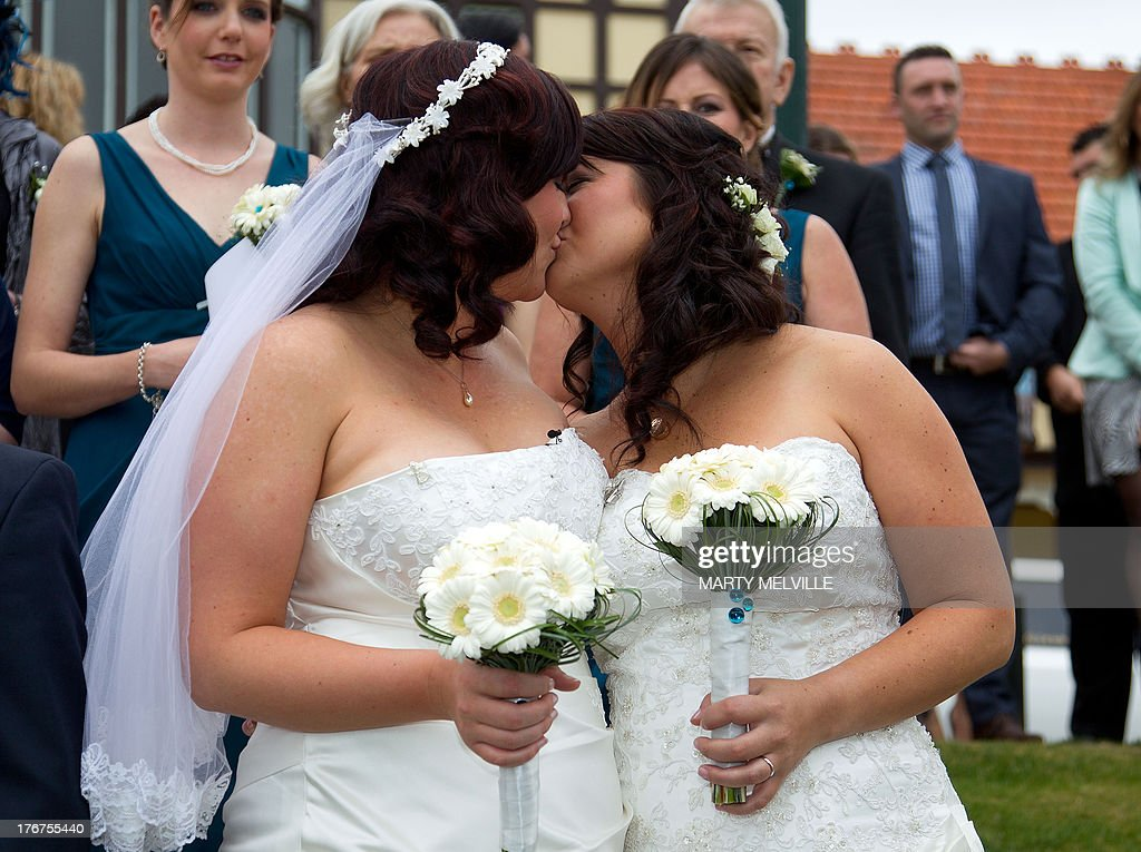 Jess Ives (R) and Rachel Briscoe from the Bay of Islands celebrate being married during the first same sex marriage at the Rotorua Museum in Rotorua on Monday, August 19, 2013. More than 30 same-sex couples will say 'I do' on Monday when New Zealand becomes the first Asia-Pacific country and only the 14th in the world to legalise gay marriage. The move has sparked a raft of competitions to set wedding firsts, but unease amongst the religious community.