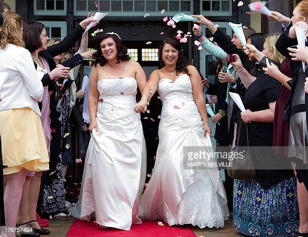 Jess Ives R and Rachel Briscoe from the Bay of Islands celebrate being married during the first same sex marriage at the Rotorua Museum in Rotorua on...