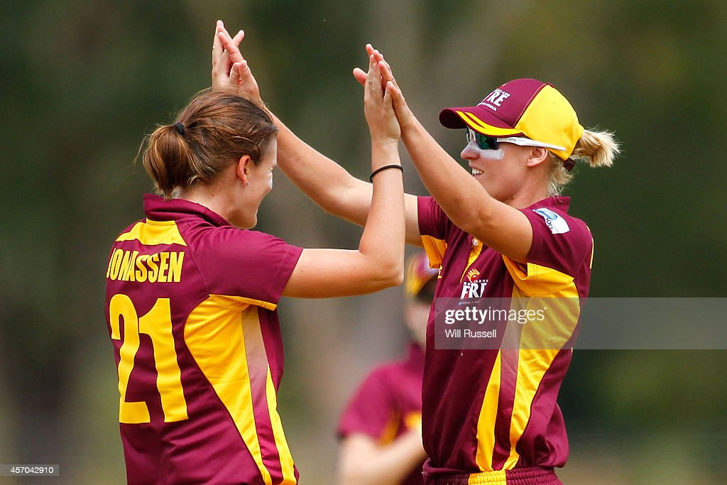 Jess Jonassen and Delissa Kimmince of The Queensland Fire celebrate after taking the wicket of Megan Banting of The Western Fury during the WNCL...