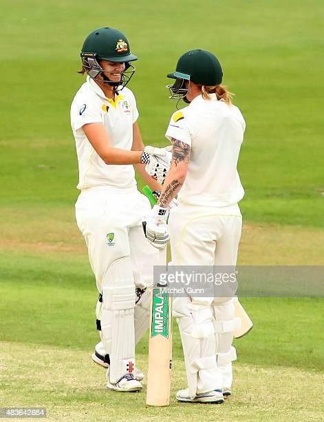 Jess Jonassen of Australia celebrates scoring a half century during day one of the Kia Women's Test of the Women's Ashes Series between England and...