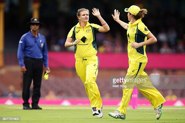 Jess Jonassen of Australia celebrates with team mates after taking the wicket of VR Vanitha of India during the International Twenty20 match between...