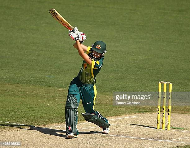 Jess Jonassen of Australia hits out during game three of the International Women's Twenty20 match between Australia and the West Indies at Melbourne...