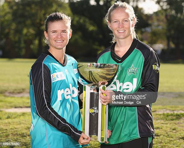 Jess Jonassen of the Brisbane Heat and Meg Lanning of the Melbourne Stars pose with the trophy during the Women's Big Bash League Launch at Toorak...