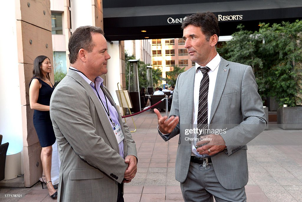 Jess Kraus, Chief Executive Officer Source Intelligence (L) and Paul Dewar, MP, Parliament of Canada attend the Global Conflict Minerals Symposium Dinner Presented by Source Intelligence at Omni Los Angeles Hotel on August 21, 2013 in Los Angeles, California.