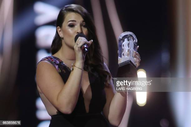 Jess Moskaluke who won Country Album of the Year performs during JUNO awards show at the Canadian Tire Centre in Ottawa Ontario on April 2 2017 / AFP...