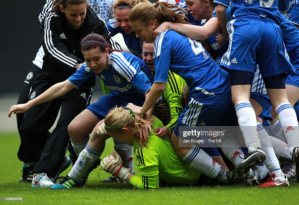 Jess Myers, Goalkeeper of Chelsea is mobbed by team mates during the FA Girls' Youth Cup U17s Centre of Excellence Final between Arsenal and Chelsea at Stadium MK on May 6, 2012 in Milton Keynes, England.