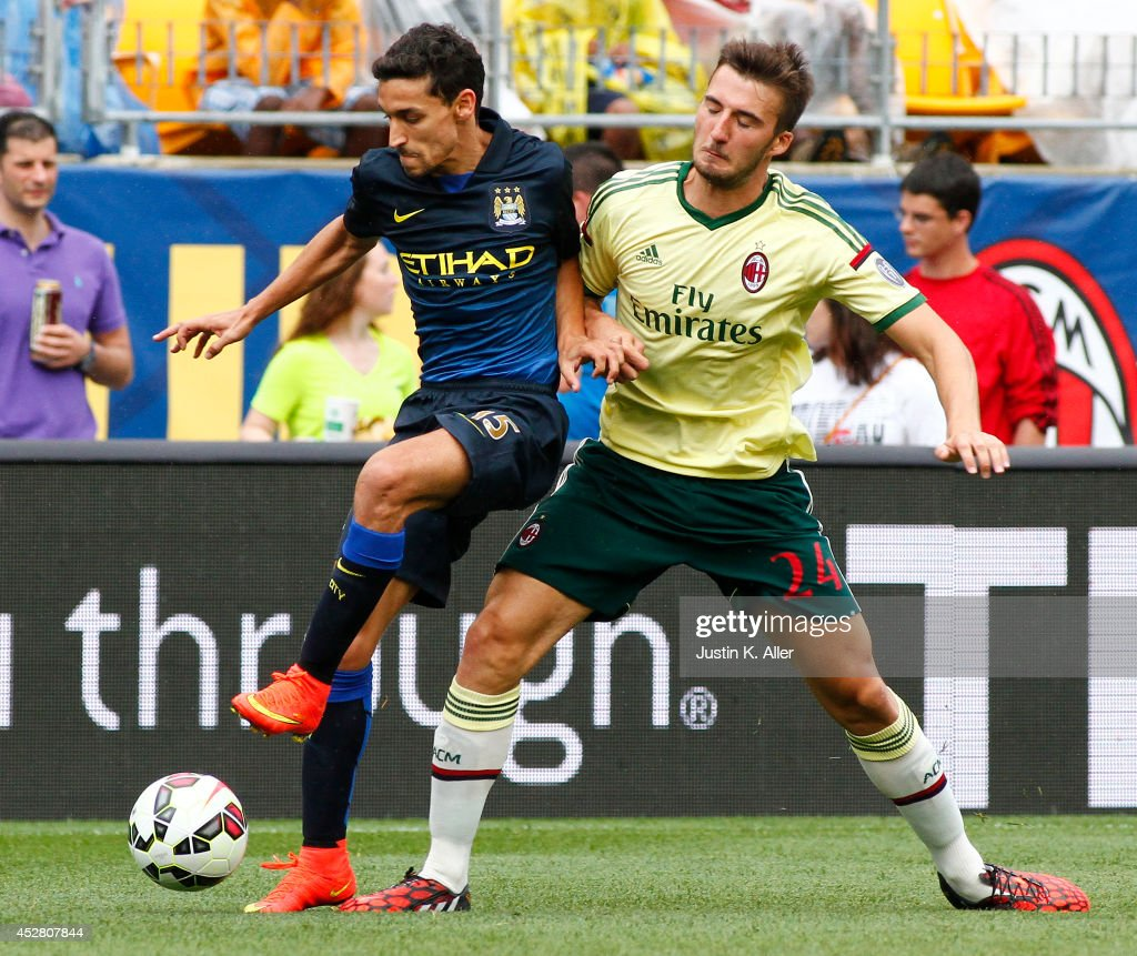 Jess Navas #15 of Manchester City handles the ball around <a gi-track='captionPersonalityLinkClicked' href=/galleries/search?phrase=Bryan+Cristante&family=editorial&specificpeople=8928294 ng-click='$event.stopPropagation()'>Bryan Cristante</a> #24 of AC Milan in the second half during International Champions Cup 2014 at Heinz Field on July 27, 2014 in Pittsburgh, Pennsylvania.