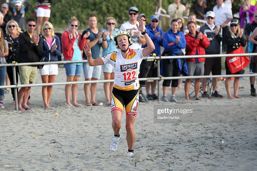 Jess Simson of Wanaka celebrates winning the Women's one day individual event during the Speights Coast to Coast on February 15, 2014 in Christchurch, New Zealand.