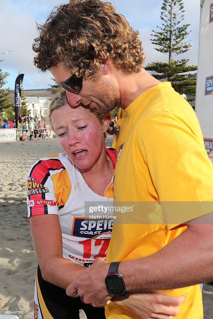 Jess Simson of Wanaka is helped after winning the one day individual event during the Speights Coast to Coast on February 15, 2014 in Christchurch, New Zealand.